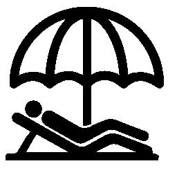 傘の無料のアイコンの下のビーチで寝そべっている人